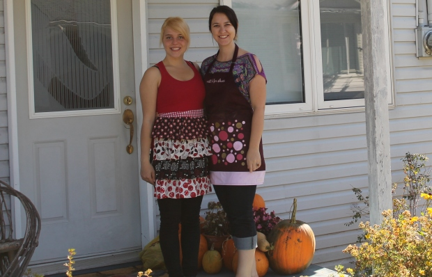 "That's my little sister and I. My apron says ""Will cook for shoes""."